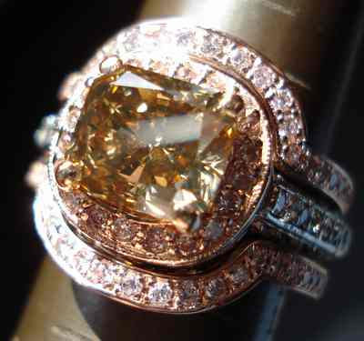 the image httpdiamondsbylaurencomimages0602 - Pink Diamond Wedding Ring