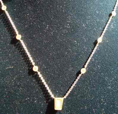 fancy intense yellow diamond necklace canary diamonds