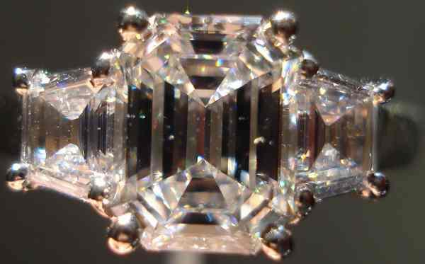 emerald cut three stone diamond ring