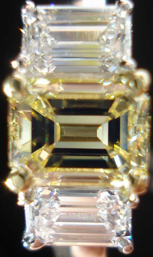 fancy yellow emerald cut diamond engagement ring with