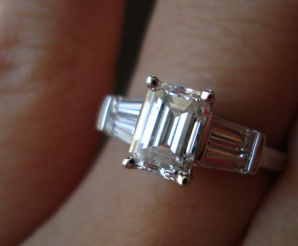 emerald cut diamond ring with double baguettes