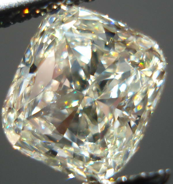 M color diamond | Cushion cut | SI2 diamonds | Photos