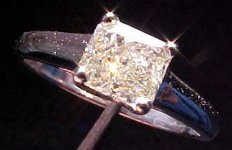SOLD.....Ring: .55carat Natural Faint Yellow Radiant GIA Report R1051