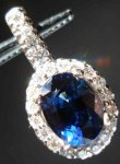 SOLD.... Sapphire & Diamond Halo Pendant: White Gold R2560