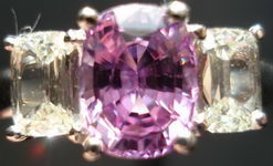 SOLD....Sapphire and Diamond Ring: Purple-Pink Sapphire w .71ct tw Cushion Diamond Sides R2786