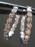 Diamond Hoop Earrings: .87ct Small, but they pack a punch Inside facing stones SO3260