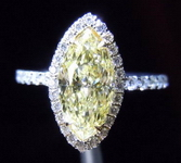 SOLD.....Halo Diamond Ring: 1.16 Fancy Light Yellow SI2 Marquise Shape Diamond GIA Platinum 18kt gold R3495