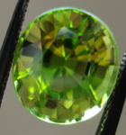 SOLD....Loose Peridot: Precision Cut 4.32ct Peridot Oval Shape R3541