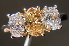 SOLD....Three Stone Ring: .52ct Fancy Light Brownish Yellow Oval Shape Diamond With Oval Side Stones R3599