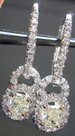 SOLD....Diamond Halo Earrings: .76ctw Natural Light Yellow Radiant Diamond Dangle Halo R3813