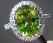 SOLD....Peridot Diamond Ring: Precision Cut 4.22ct Oval Shape Beautiful Color 14kt white gold R3904