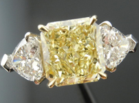 Three Stone Diamond Ring: 2.05ct Radiant Cut Fancy Yellow SI2 GIA Heart Shape Side Stones R4081