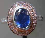 SOLD.....Sapphire and Diamond Ring: .92ct Blue Oval Shape Sapphire Pink Diamond Halo R3046