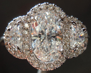 SOLD....Three Stone Ring: 1.01ct Oval Shape F/SI2 Half Moon Side 18K Halo GIA R4315