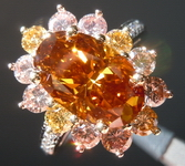 Multi Color Diamond Ring: 3.03 Fancy Deep Brown Orange Oval surrounded by Pink and Yellow Diamonds R4397