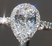 SOLD....Colorless Diamond Halo Ring: .91ct E SI1 Pear Shape GIA Uber Halo R4491