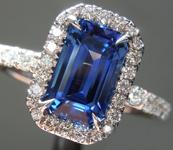 Sapphire Ring: 1.97ct Blue Emerald Cut Sapphire and Diamond Halo Ring R5753