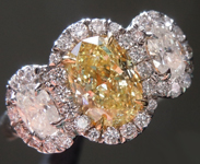 SOLD...Yellow Diamond Ring: .95ct Fancy Yellow VVS2 Oval Shape Three Stone Diamond Halo Ring GIA R6110