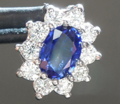 SOLD..........Sapphire Pendant: .45ct Blue Oval Shape Sapphire and Diamond Halo Pendant R6181