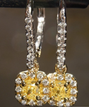 SOLD.......Diamond Halo Earrings: .67cts Fancy Intense Yellow VS Cushion Cut Diamond Earrings R7388