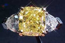 SOLD.....Ring: GIA 2.00ct Fancy Intense Yellow Cushion Cut w/.73ctw heart diamonds R1693