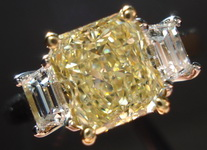 Three Stone Diamond RIng: GIA 1.51ct SI1 Platinum Fancy Light Yellow Diamond ring w/ .47ctw Step Cut R1519