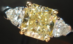 SOLD.....Three Stone Diamond Ring: GIA 1.30ct Radiant Fancy Light Yellow Diamond w/ heart side stone R1602