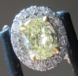 Diamond Pendant: .48ct Fancy Light Yellow VS1 Oval Diamond Halo Pendant GIA R6569