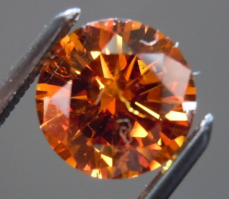 1 19ct Orange I1 Round Diamond Ring