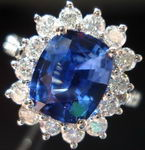 SOLD.....Sapphire and Diamond Halo Ring: 2.32 Lapis Lazuli Blue Cushion Sapphire surrounded by white round diamonds R2500
