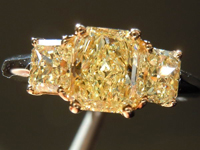 SOLD.... Three Stone Diamond Ring: .86ct W-X Light Yellow Radiant GIA with Matching Side Stones R3254