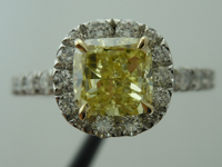 SOLD....Halo Diamond Ring: 1.02ct Fancy Yellow Cushion SI1 GIA Platinum and 18K Yellow Gold R3455