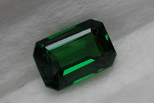 SOLD.....Halo Tsavorite Ring: 1.51 Emerald Cut luscious green color 18kt white gold R3511