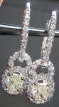 SOLD....Diamond Halo Earrings: .76ctw Natural Light Yellow Radiant Diamond Dangle Halo R3813