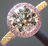SOLD....Crafted by Infinity Round Brilliant Diamond 1.01 N/SI1 set in a Pink/Yellow Diamond Halo AGSL R4438