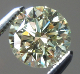 SOLD.....0.86ct Gray-Greenish Yellow SI2 Round Brilliant Diamond R5925