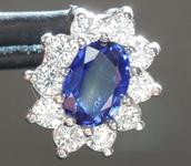 SOLD..........Sapphire Pendant: .45ct Blue Oval Shape Sapphire and Diamond Halo Pendant R6181