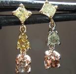 SOLD....... 0.83ctw Fancy Colored Diamond Earrings R7724