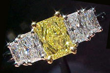 SOLD....Ring- GIA .95ct Intense Radiant Cut Yellow Diamond w/4 White Radiant Side Stones R1537
