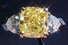 SOLD.....Ring: GIA 2.00ct Fancy Intense Yellow Cushion Cut w/.73ctw heart diamonds R1693