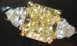 SOLD.....Three Stone Diamond Ring: GIA 1.30ct Radiant Fancy Light Yellow Diamond w/ heart side stone R1602
