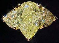 SOLD....Three Stone Diamond Ring: GIA 2.84ct Pear Intense Yellow Diamond R1795